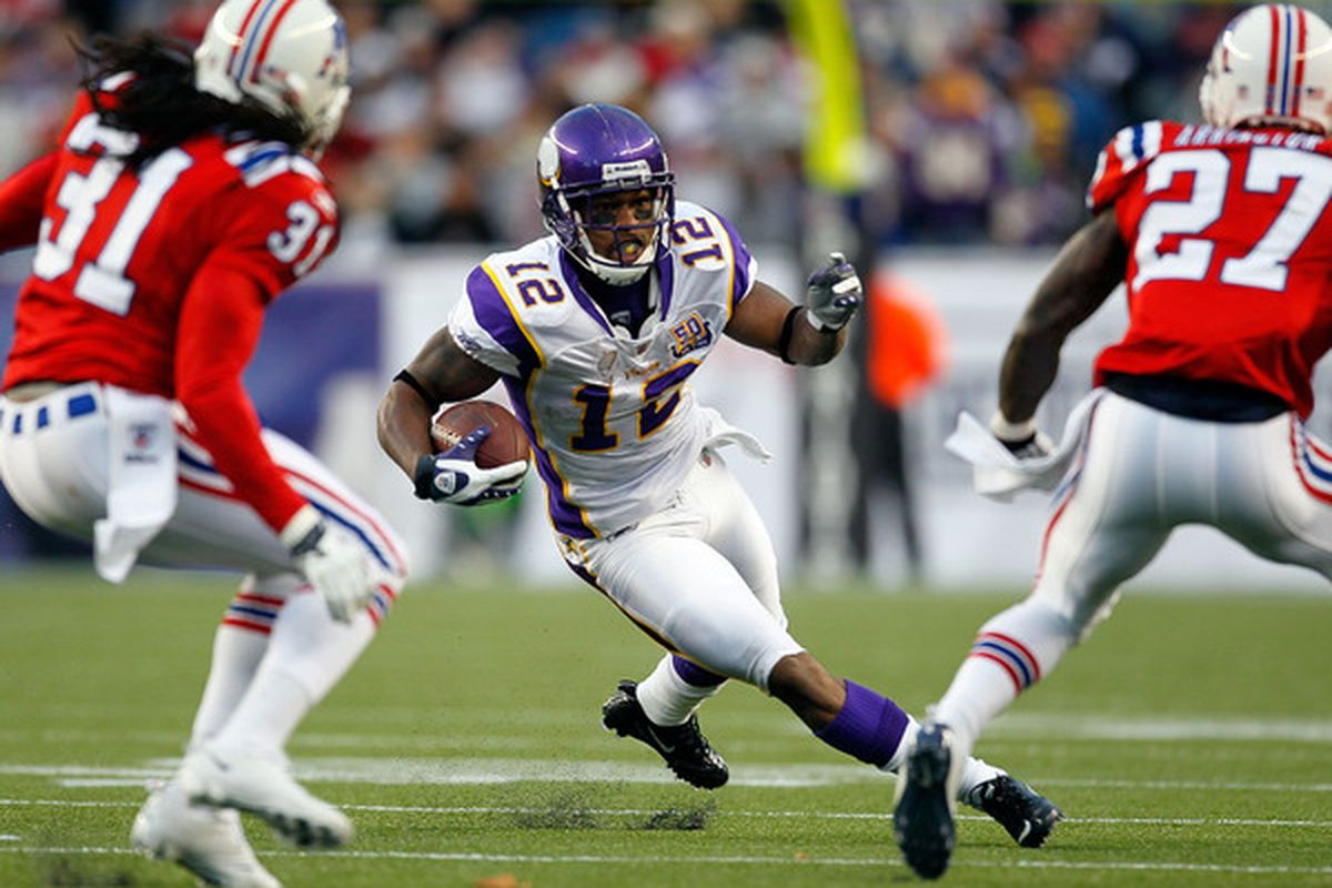 FOXBORO MA - OCTOBER 31:  Percy Harvin #12 of the Minnesota Vikings gains yardage against the New England Patriots at Gillette Stadium on October 31 2010 in Foxboro Massachusetts. (Photo by Jim Rogash/Getty Images)