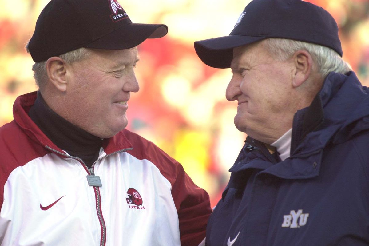 BYU coach LaVell Edwards and Utah coach Ron McBride greet each other before the game at Rice-Eccles Stadium in 2000.