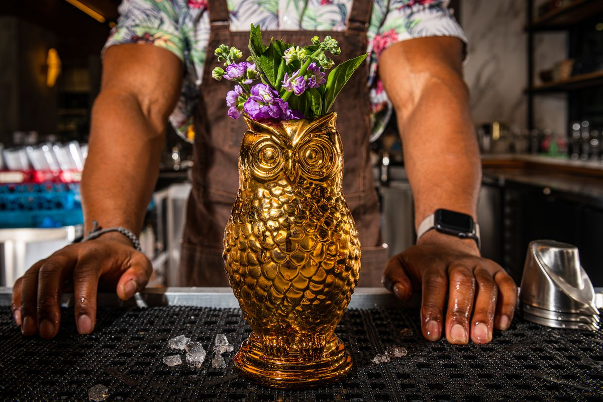 Served in a golden owl mug, the Take Care combines applejack, aquavit, and Cynar with a fruity-citrus mix of lime, pomegranate, and elderflower.