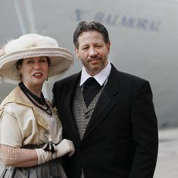 Mary Beth Crocker Dearing and her husband Tom Dearing from Newport Ky.  pose for the media in period  costume as they wait to board the MS Balmoral cruise ship in Southampton, England, Sunday, April  8, 2012. Nearly 100 years after the Titanic went down, a cruise with the same number of passengers aboard is setting sail to retrace the ship's voyage, including a visit to the location where it sank. The Titanic Memorial Cruise is set to depart Sunday from Southampton, where the Titanic left on its maiden voyage. The 12-night cruise will commemorate the 100th anniversary of the sinking of the White Star liner. With 1,309 passengers aboard, the MS Balmoral will follow the same route as the Titanic. Organizers are trying to recreate the onboard experience  minus the disaster  from the food to a band playing music from that era.Organizers said people from 28 countries have booked passage, including relatives of some of the more than 1,500 people who died when the Titanic collided with an iceberg and sank on April 15, 1912.