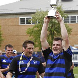 Team captain Ryan Roundy holds up the trophy as BYU defeats Cal 27-24 in rugby on a drop as time expires to win the Varsity Cup national championship Saturday, May 4, 2013, in Provo.