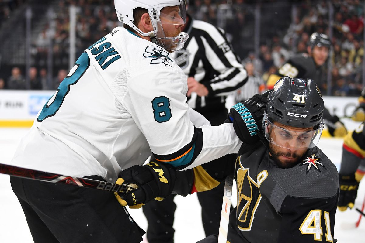 San Jose Sharks center Joe Pavelski (8) shoves Vegas Golden Knights center Pierre-Edouard Bellemare (41) to the ice during the first period of game six of the first round of the 2019 Stanley Cup Playoffs at T-Mobile Arena.