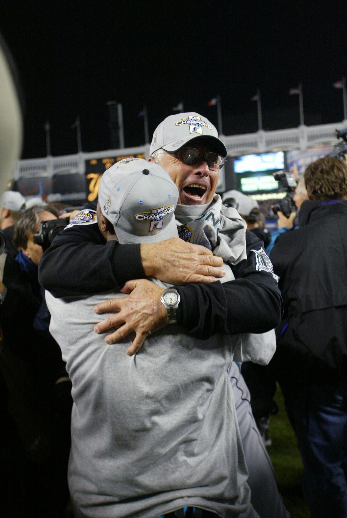 Florida Marlins' manager Jack McKeon gets a big hug after th