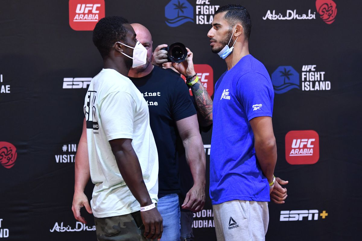 Opponents Abdul Razak Alhassan of Ghana and Mounir Lazzez of Tunisia face off during the UFC Fight Night weigh-in inside Flash Forum on UFC Fight Island on July 14, 2020 in Yas Island, Abu Dhabi, United Arab Emirates.