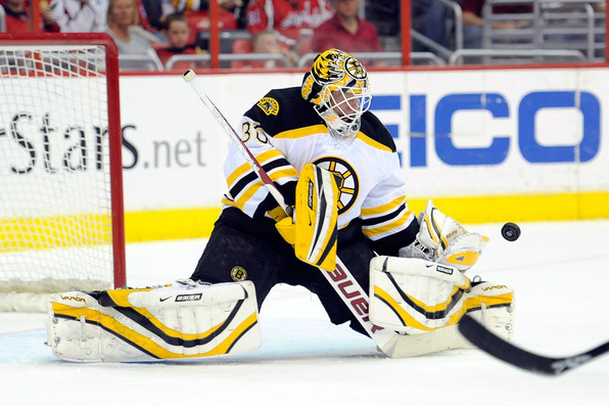 WASHINGTON - APRIL 11:  Tim Thomas #30 of the Boston Bruins makes a save against the Washington Capitals at the Verizon Center on April 11, 2010 in Washington, DC.  (Photo by Greg Fiume/Getty Images)