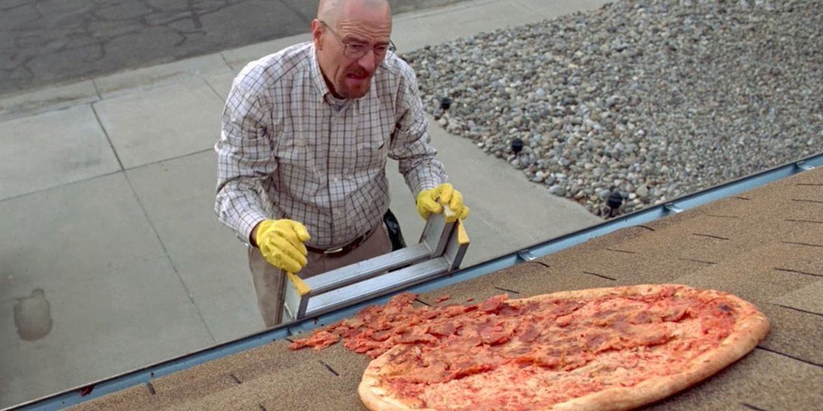 """Walter White climbs a ladder to fetch a pizza off a house roof in """"Breaking Bad."""""""