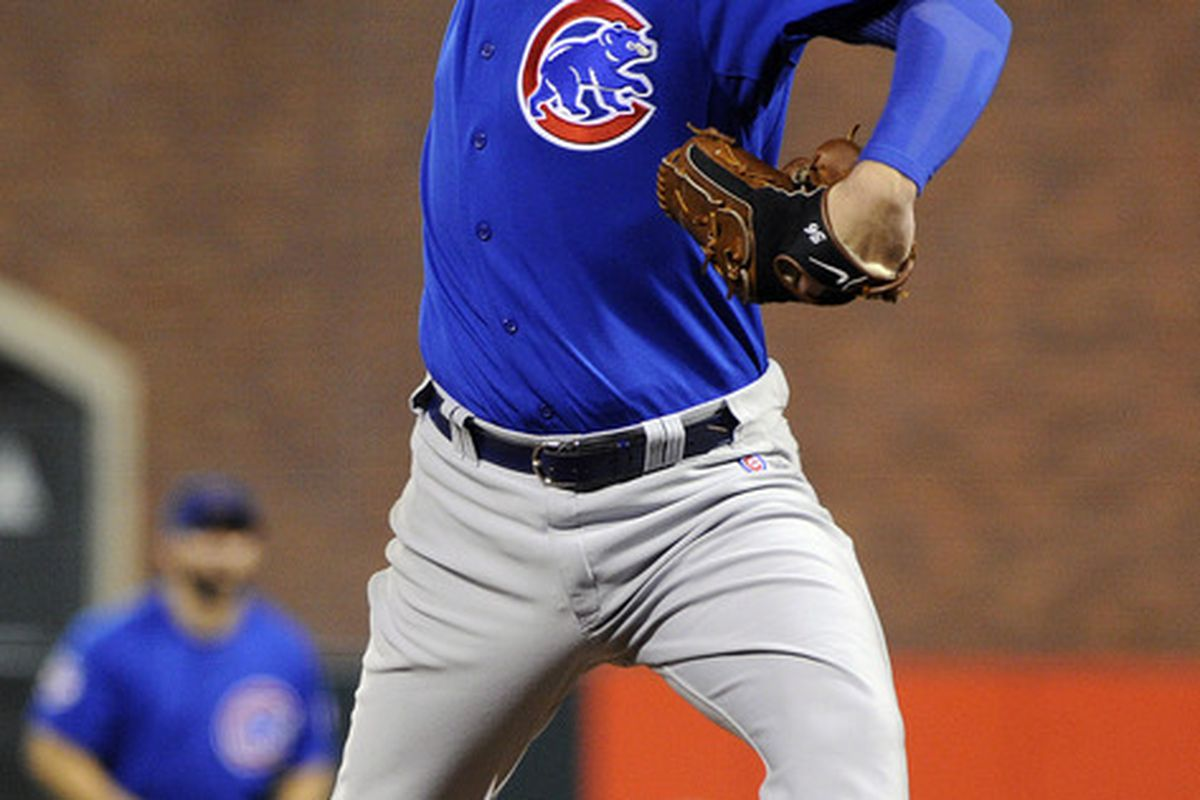 Randy Wells of the Chicago Cubs pitches against the San Francisco Giants in the eighth inning during an MLB baseball game at AT&T Park in San Francisco, California. The Cubs won the game 7-0. (Photo by Thearon W. Henderson/Getty Images)