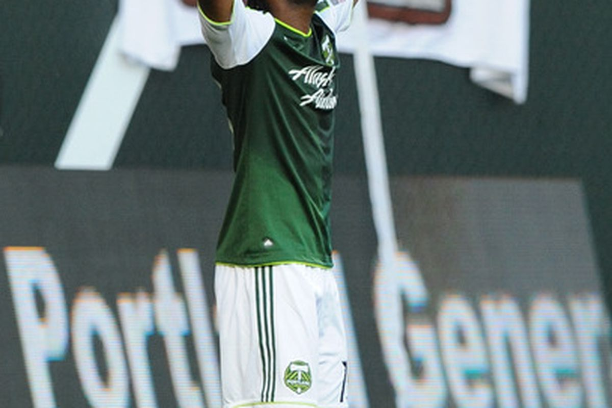 PORTLAND, OR - AUGUST 20: Jorge Perlaza #15 of the Portland Timbers celebrates after scoring a goal during the first half of the game against Vancouver FC at Jeld-Wen Field on August 20, 2011 in Portland, Oregon. (Photo by Steve Dykes/Getty Images)