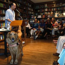 """In this June 28, 2011 photo, formerU.S. Army Captain Luis Carlos Montalvan speaks as his service dog """"Tuesday"""" looks on at a book signing for his book """"Until Tuesday,"""" at a book store in Coral Gables, Fla. Since serving two tours of duty, for which he received two Bronze Stars and the Purple Heart, the former Army captain has become a strong critic of the war and an advocate for better care of those who served."""