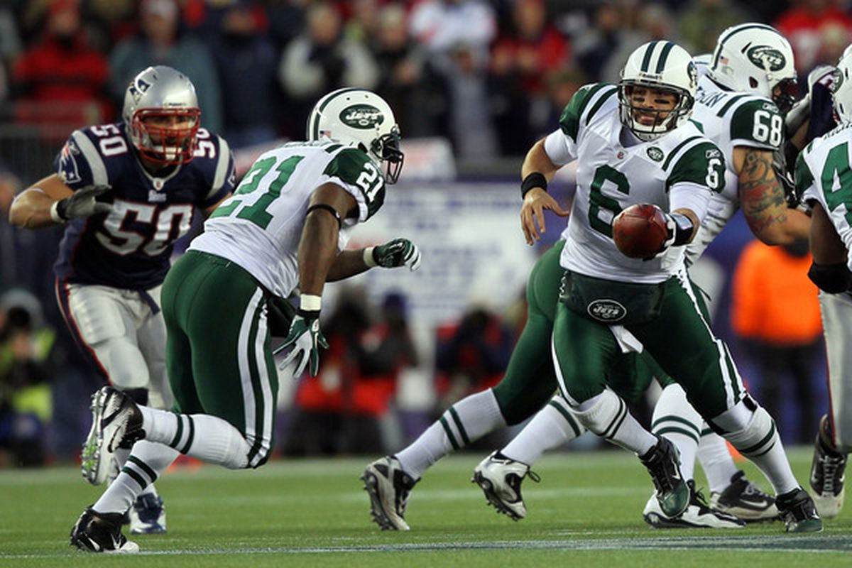 Mark Sanchez in his best role as an NFL QB: handing the ball off.