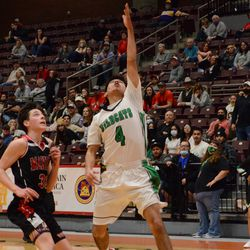 Wendover's Orlando Alvarez puts in a shot under pressure Friday night during the 1A boys' semifinals game.