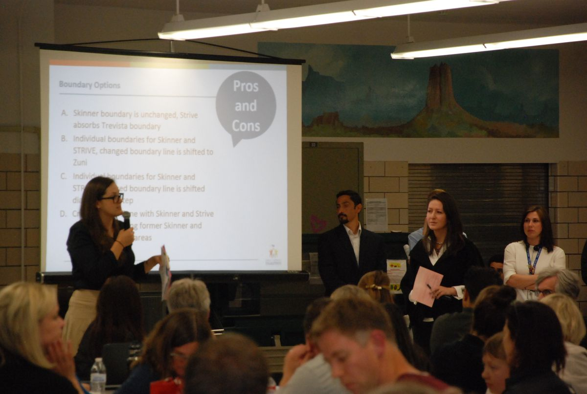 Principals from Skinner Middle School, right, and STRIVE Sunnyside, left, describe their schools at a community meeting in Northwest Denver.