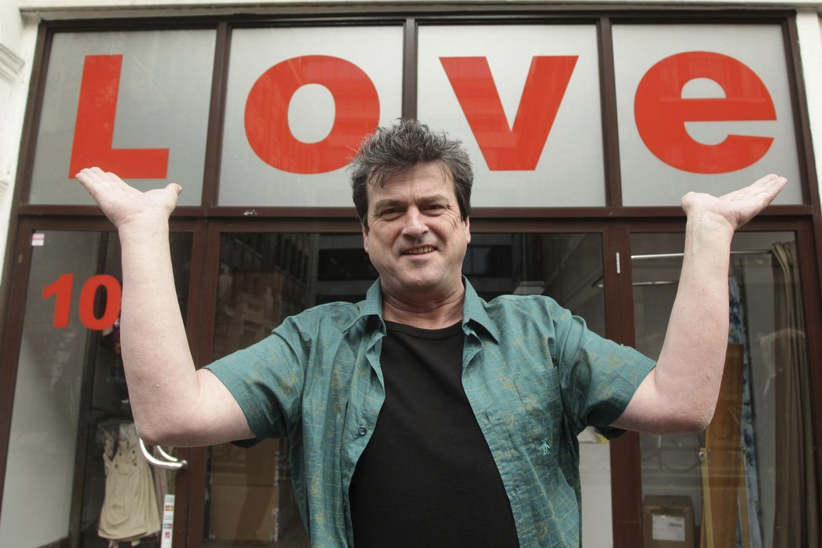"""Bay City Rollers singer Les McKeown poses for the media during a photocall to celebrate the release of the band's career retrospective boxset, """"Rollermania: Bay City Rollers The Anthology"""" in London in 2010."""