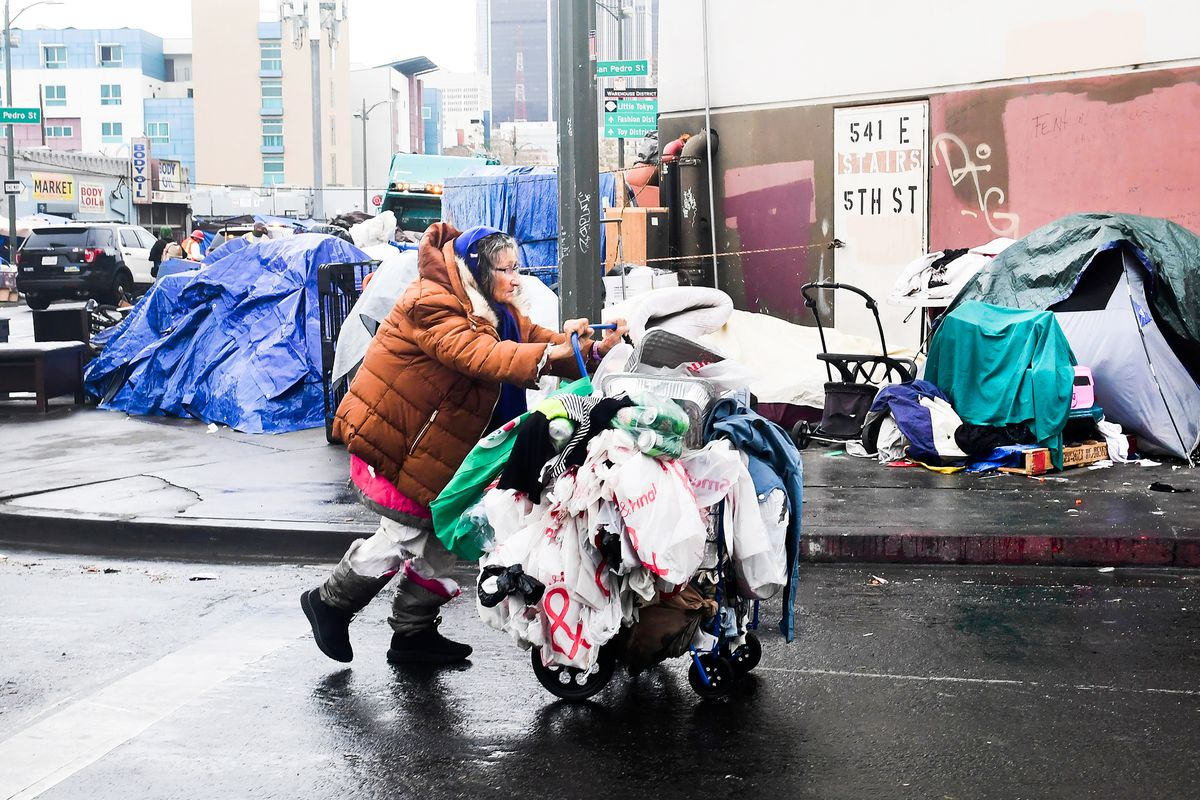 A woman walks past a row of tents in Los Angeles on February 1.