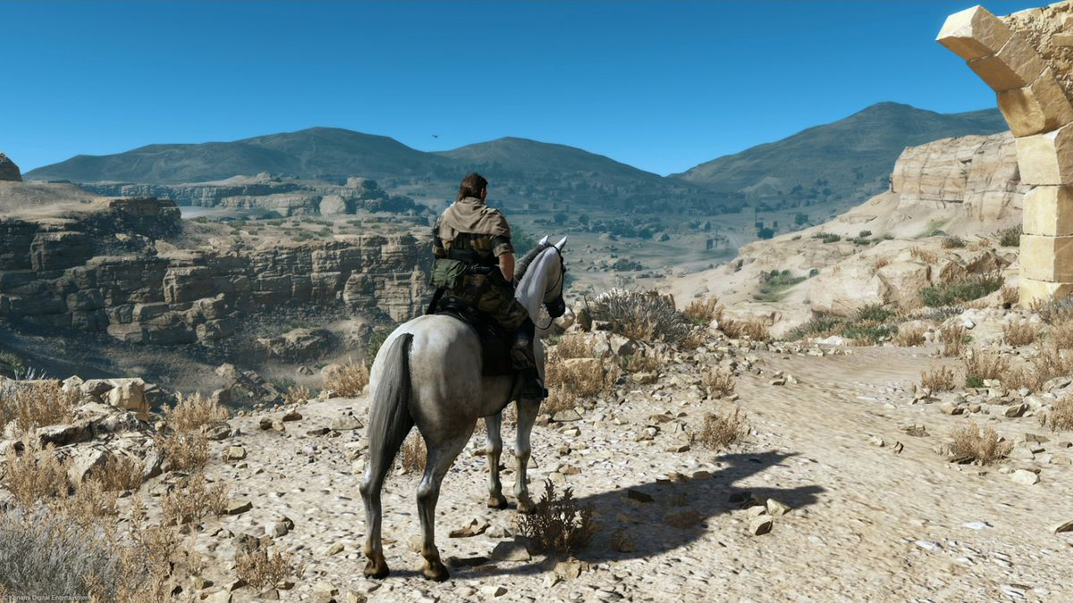 A player sits atop a horse facing off into the distance in Metal Gear Solid 5