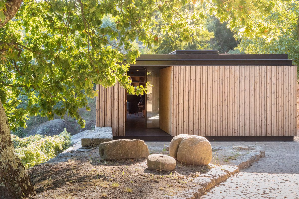Exterior of timber home surrounded by trees