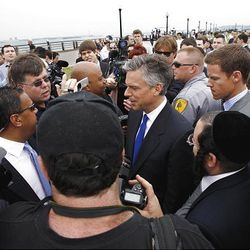 Former Utah Gov. Jon Huntsman, center, listens to questions after announcing his bid for the Republican presidential nomination, Tuesday, June 21, 2011, at Liberty State Park in Jersey City, N.J.