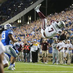 Mississippi State Bulldogs quarterback Nick Fitzgerald (7) flips into the air as he scores a touchdown in OT as BYU and Mississippi State play in Provo at LaVell Edwards Stadium on Friday, Oct. 14, 2016.