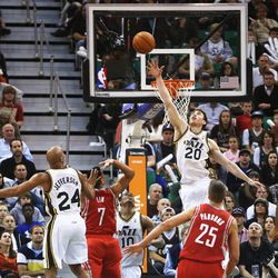 Utah Jazz's small forward Gordon Hayward (20) tries to block a shot attempt by Houston's Jeremy Lin as the Jazz and the Rockets play Saturday, Nov. 2, 2013 in EnergySolutions arena. Jazz lost 104-93.