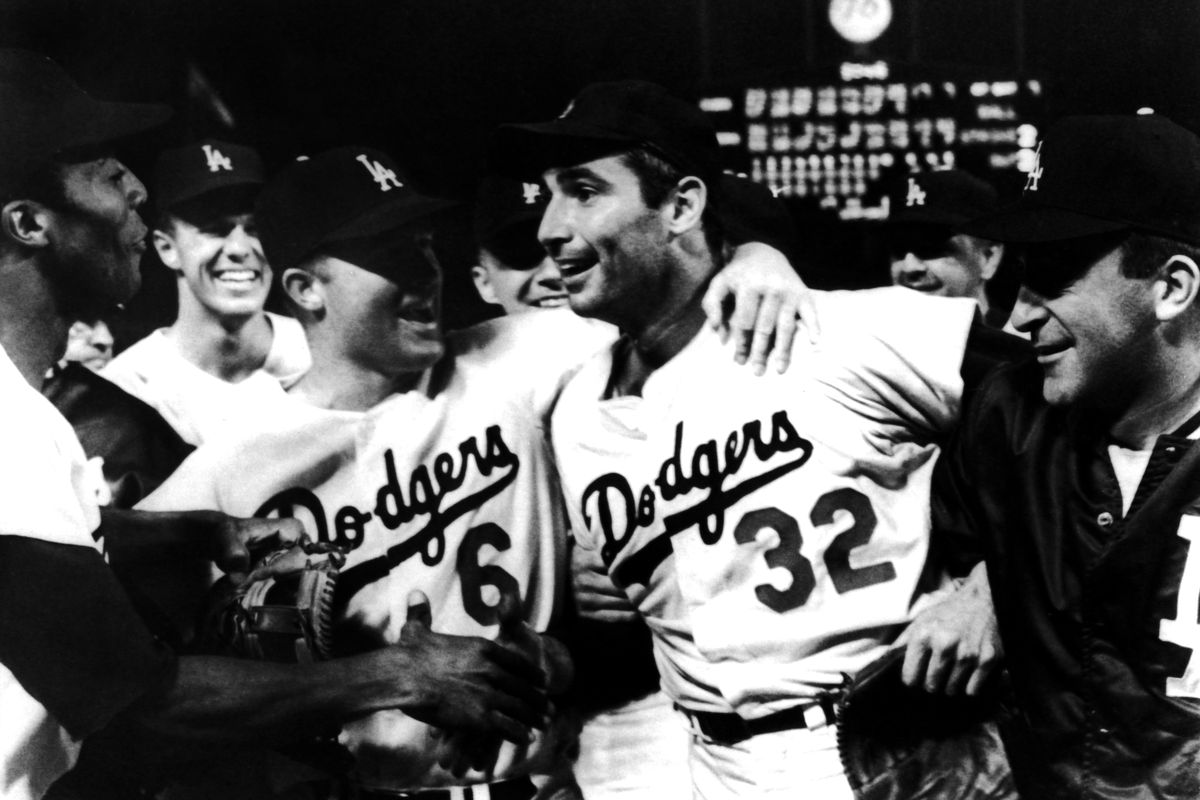 Sandy Koufax was mobbed by his teammates after pitching a perfect game against the Cubs on Sept. 9, 1965.