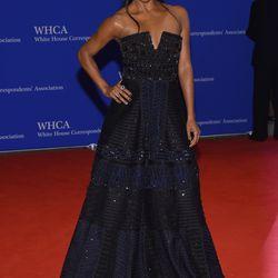 Gabrielle Union wears a Naeem Kahn dress, Kavant & Sharart jewels, a Tyler Alexandra bag, and Brian Atwood shoes.