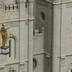 The Angel Moroni statue is removed from atop the Salt Lake Temple of The Church of Jesus Christ of Latter-day Saints during renovation in Salt Lake City on Monday, May 18, 2020.