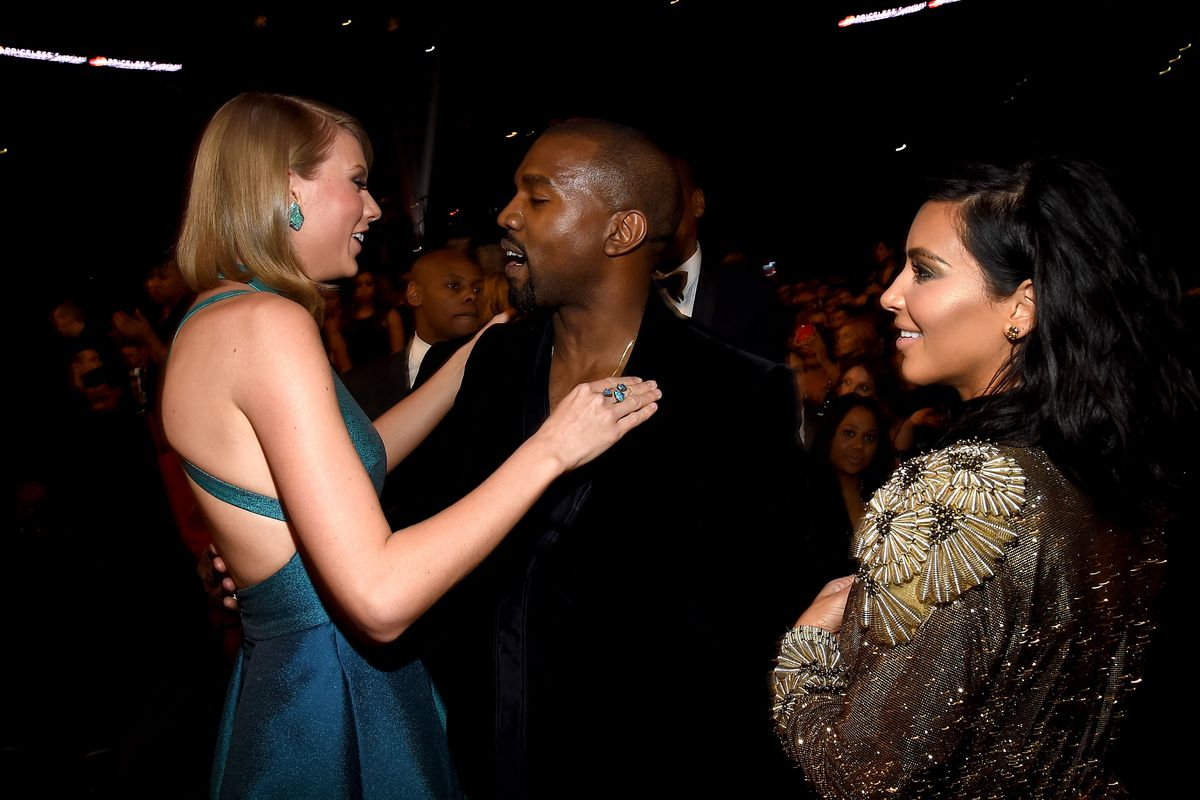 Recording Artists Taylor Swift, Kanye West, and TV personality Kim Kardashian attend the 57th Annual Grammy Awards at the Staples Center on February 8, 2015, in Los Angeles, California.