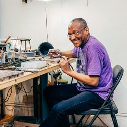Bench Jeweler Aldon Pascal is wearing a vintage Jimi Hendrix shirt, Levi's, and Church's shoes.