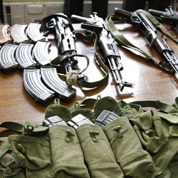 Some of the arms and  ammunition recovered by police  displayed in Nairobi, Kenya, Friday, Sep. 14, 2012. Kenyan police say they have arrested two people suspected to have links with an al-Qaida-linked Somali militant group that was in the last stages of planning a major terrorist attack on Kenya.