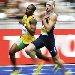 Jamaica's Ricardo Chambers, left, and  Jeremy Wariner of the U.S. compete in the men's 200-meter race of the 2009 IAAF Athletics World Championships on Tuesday in Berlin.