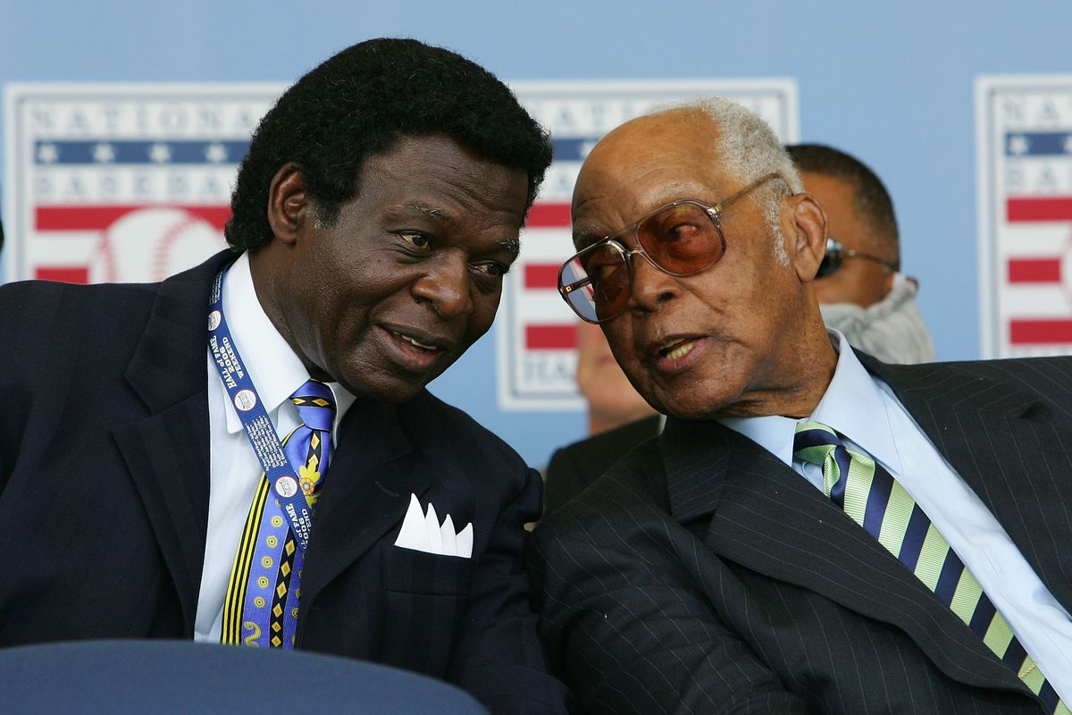 Monte, seen here with Lou Brock, talking about being great