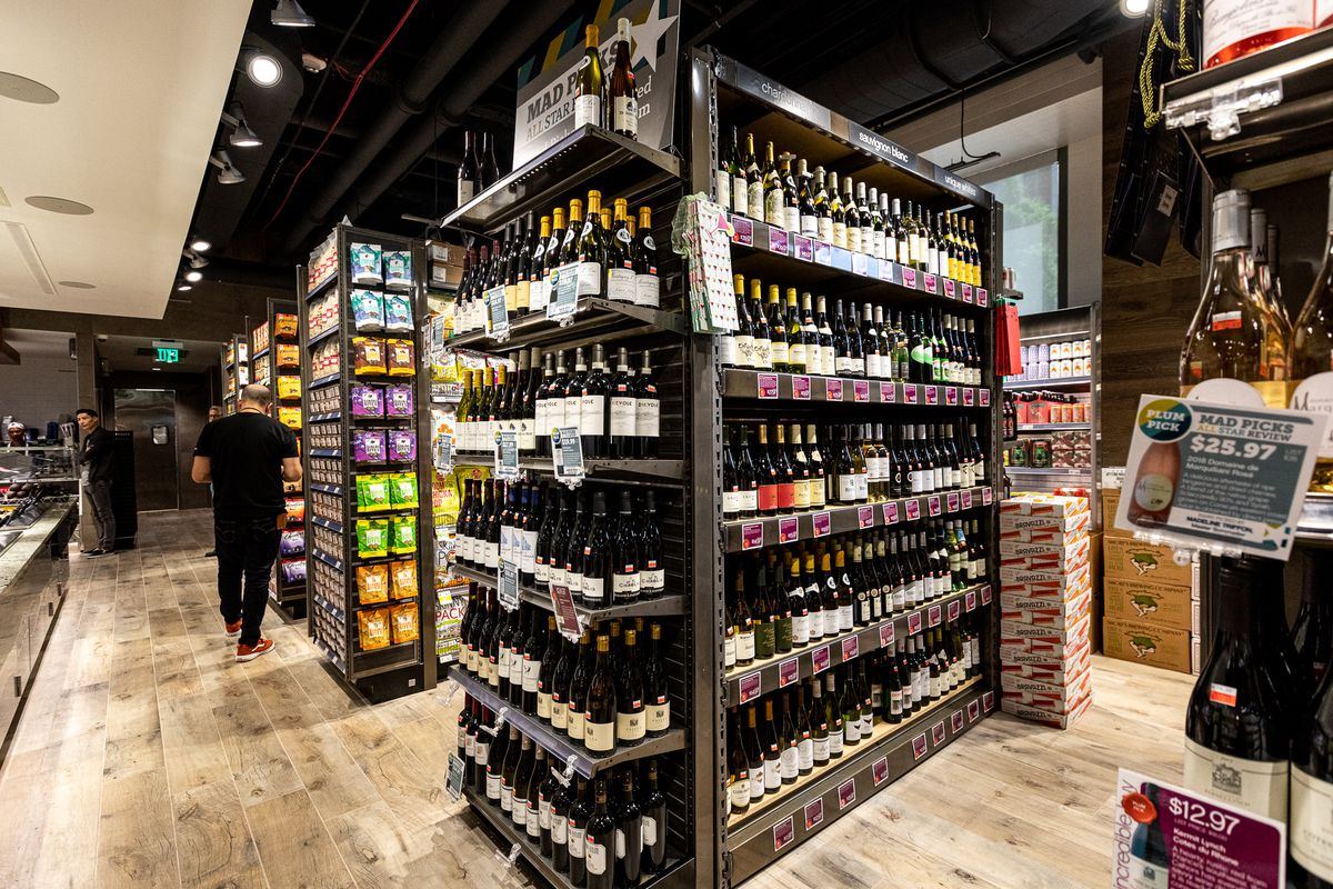 the wine section at plum market