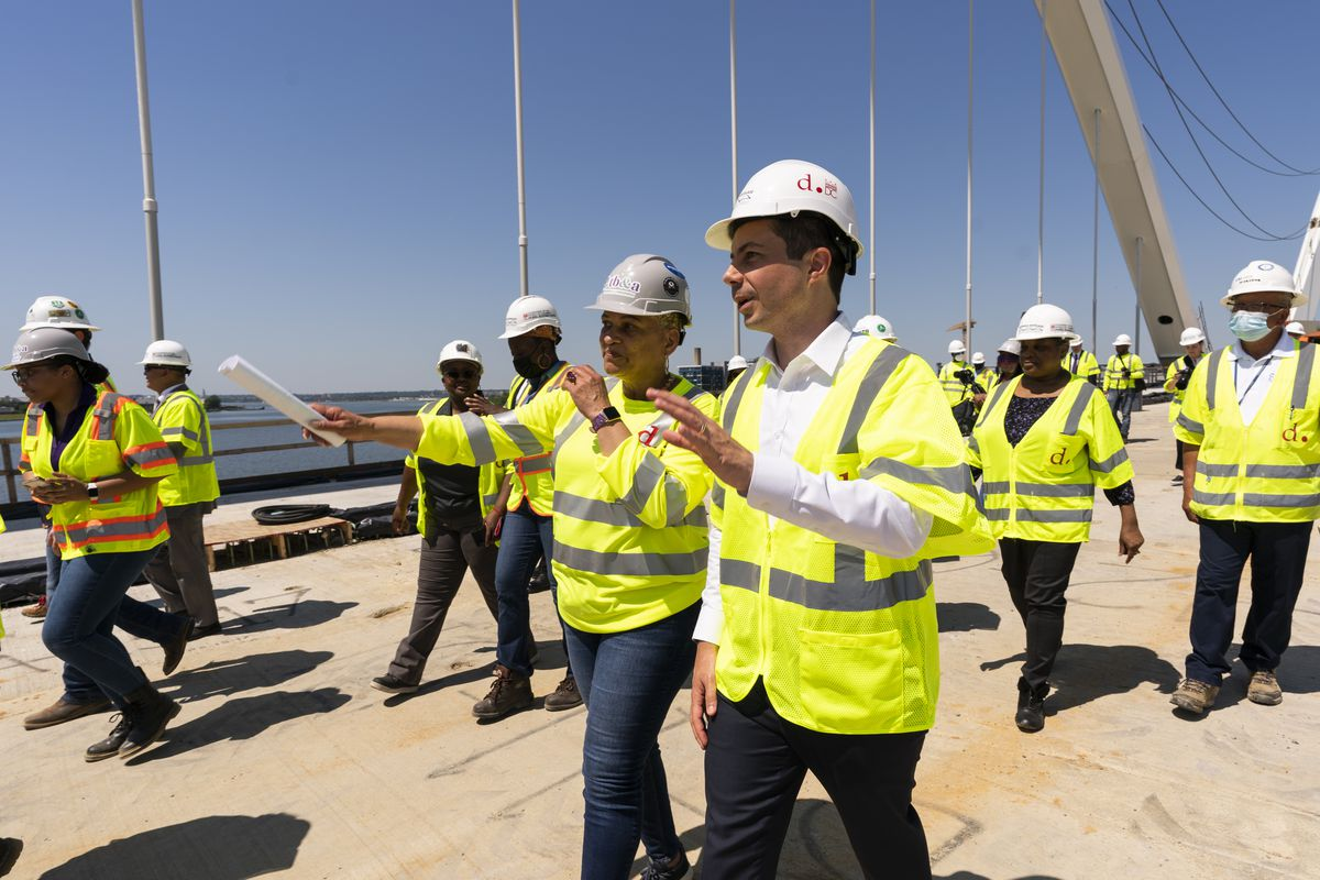Secretary of Transportation Pete Buttigieg, right, visits the Frederick Douglass Memorial Bridge construction site together with District of Columbia Mayor Muriel Bowser and Secretary of Labor Marty Walsh, in southeast Washington, Wednesday, May 19, 2021.