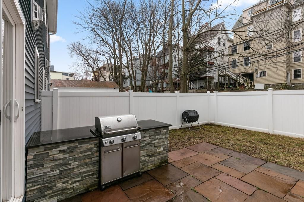 A patio with a built-in grill.