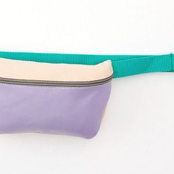 """Looking for a more budget-friendly alternative to keeping your wares at your waist? Try this retro-cool fanny pack, which comes in several color options. <b>American Apparel</b> leather fanny pack, $42 at <a href=""""http://store.americanapparel.net/product/"""