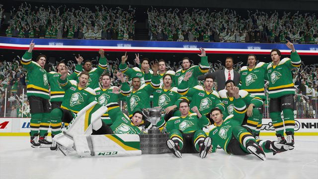 the London Knights gathered on the ice for a victory photo with the Memorial Cup in NHL 21