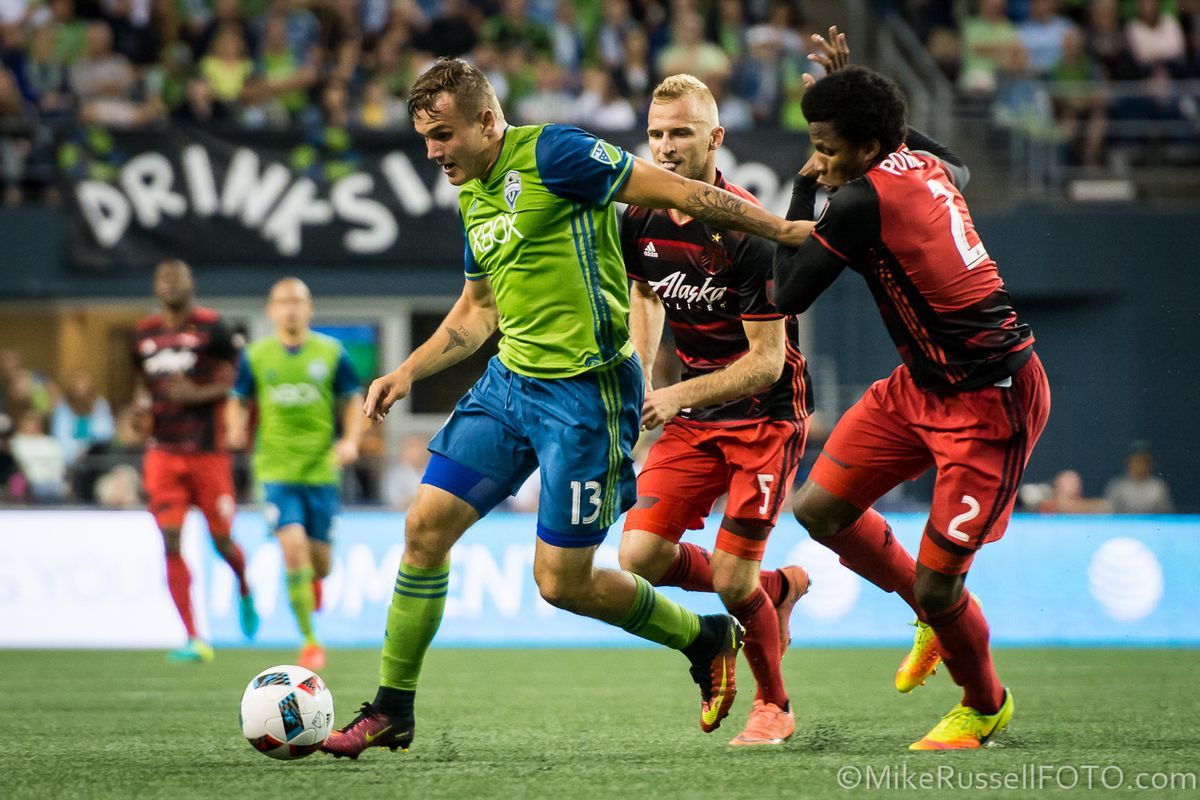 Jordan Morris bursts past Portland Timbers Alvas Powell and Steven Taylor during the 3-1 win by the Sounders.