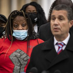 Clifftina Johnson (back, left), Tafara Williams' mother, listens as attorney Antonio Romanucci speaks during a press conference outside Waukegan's city hall complex, Tuesday morning, Oct. 27, 2020. Williams, 20, was wounded and her boyfriend, 19-year-old Marcellis Stinnette, was killed when they were both shot by a Waukegan police officer on Oct. 20.