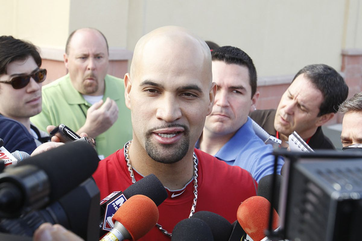 JUPITER FL - FEBRUARY 17: Albert Pujols #5 of the St. Louis Cardinals answers questions from the media at Roger Dean Stadium on February 17 2011 in Jupiter Florida. (Photo by Joel Auerbach/Getty Images)
