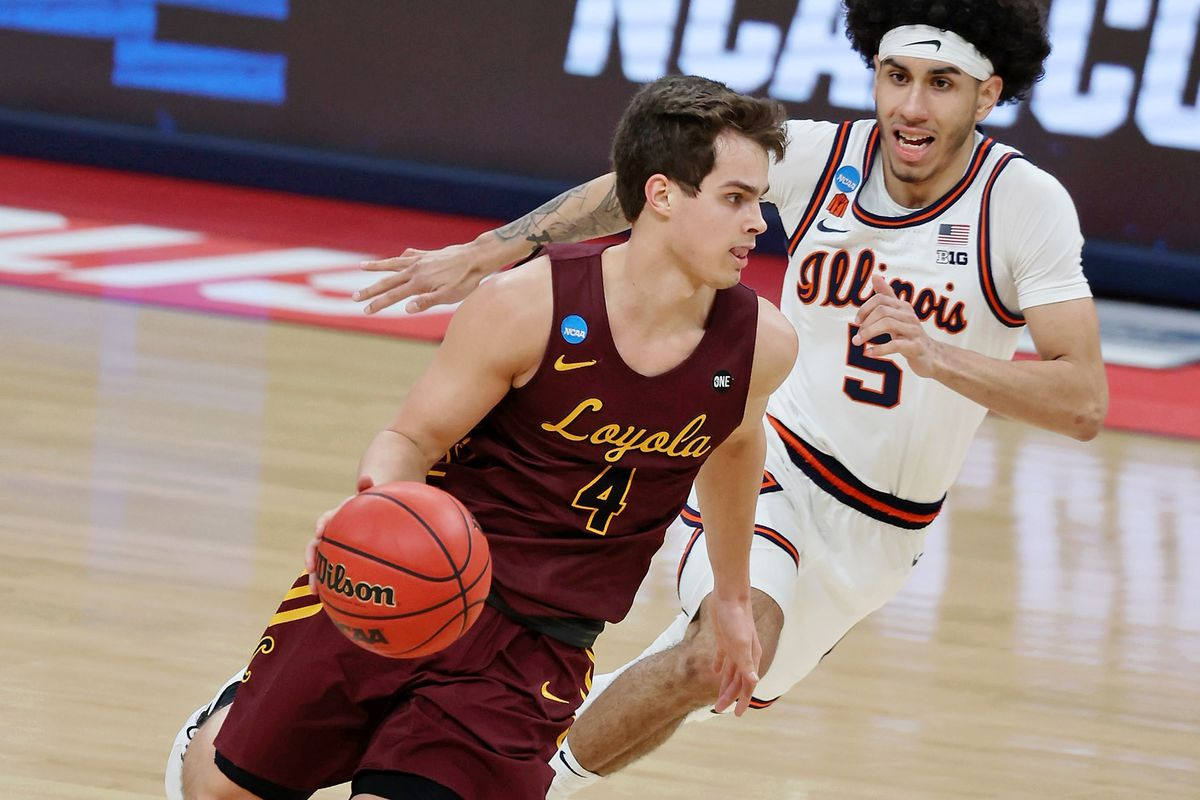 Loyola Ramblers guard Braden Norris dribbles as Illinois Fighting Illini guard Andre Curbelo pursues during the second half in the second round of the 2021 NCAA Tournament at Bankers Life Fieldhouse.