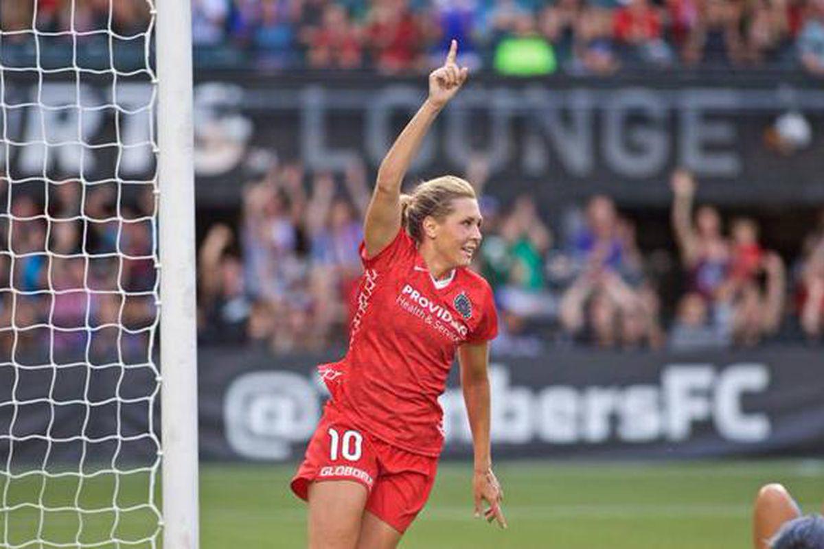 Portland's Allie Long wheels away in triumph