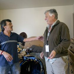 Joe Ortega and Ed Snoddy reminisce about Ortega's old dwelling spots in his room at Grace Mary Manor in South Salt Lake on Friday, Dec. 9, 2016. Ortega was living on the streets for 20 years until Snoddy convinced him to get into housing.