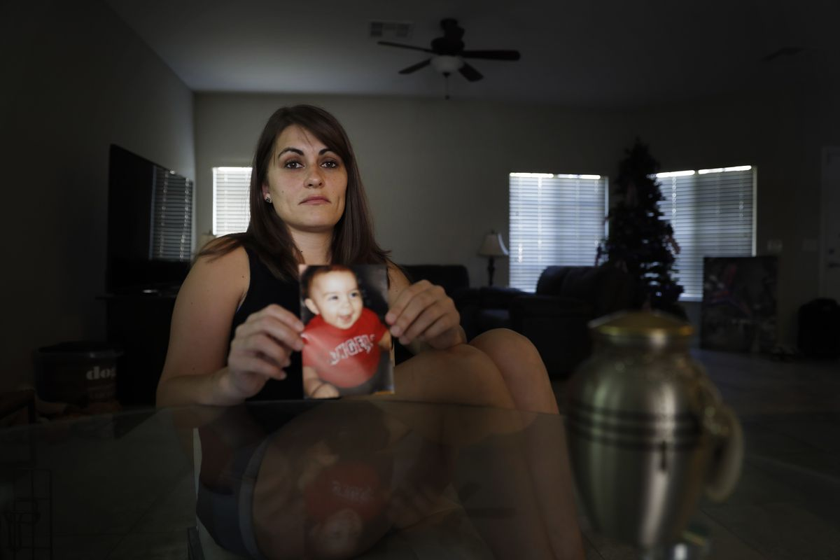 Katie Tagle with a photo of her murdered son Wyatt is pictured at her home Saturday, Aug. 10, 2019, in Las Vegas. Wyatt was murdered by his father.