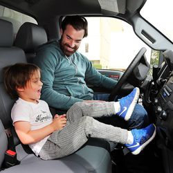 Eric Jackson talks with his son, Franklin, in Salt Lake City on Thursday, April 28, 2016, inside the truck they are using as a storage place for the family's belongings.