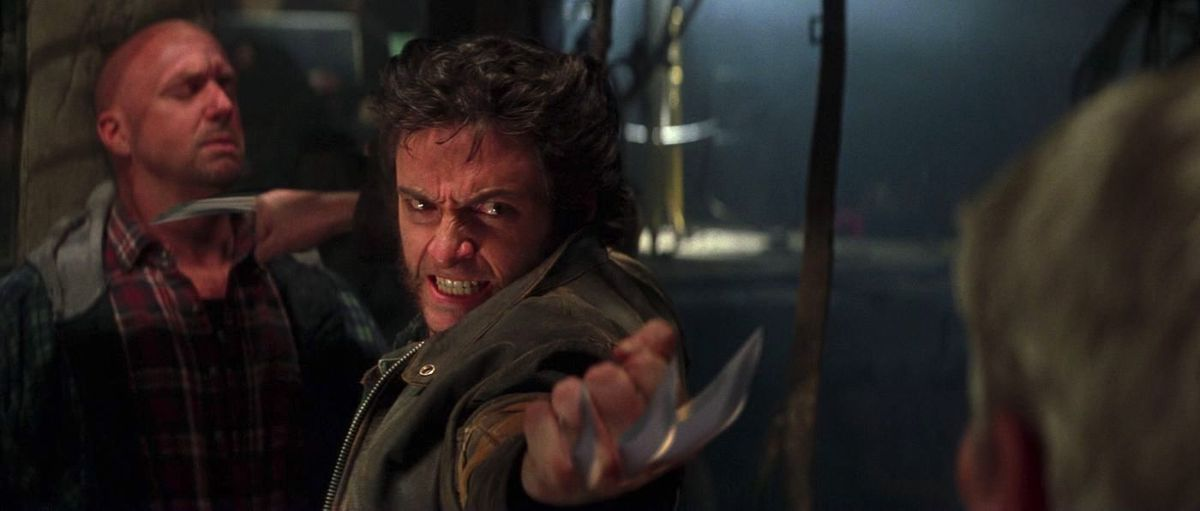 wolverine uses his blades to keep two guysback