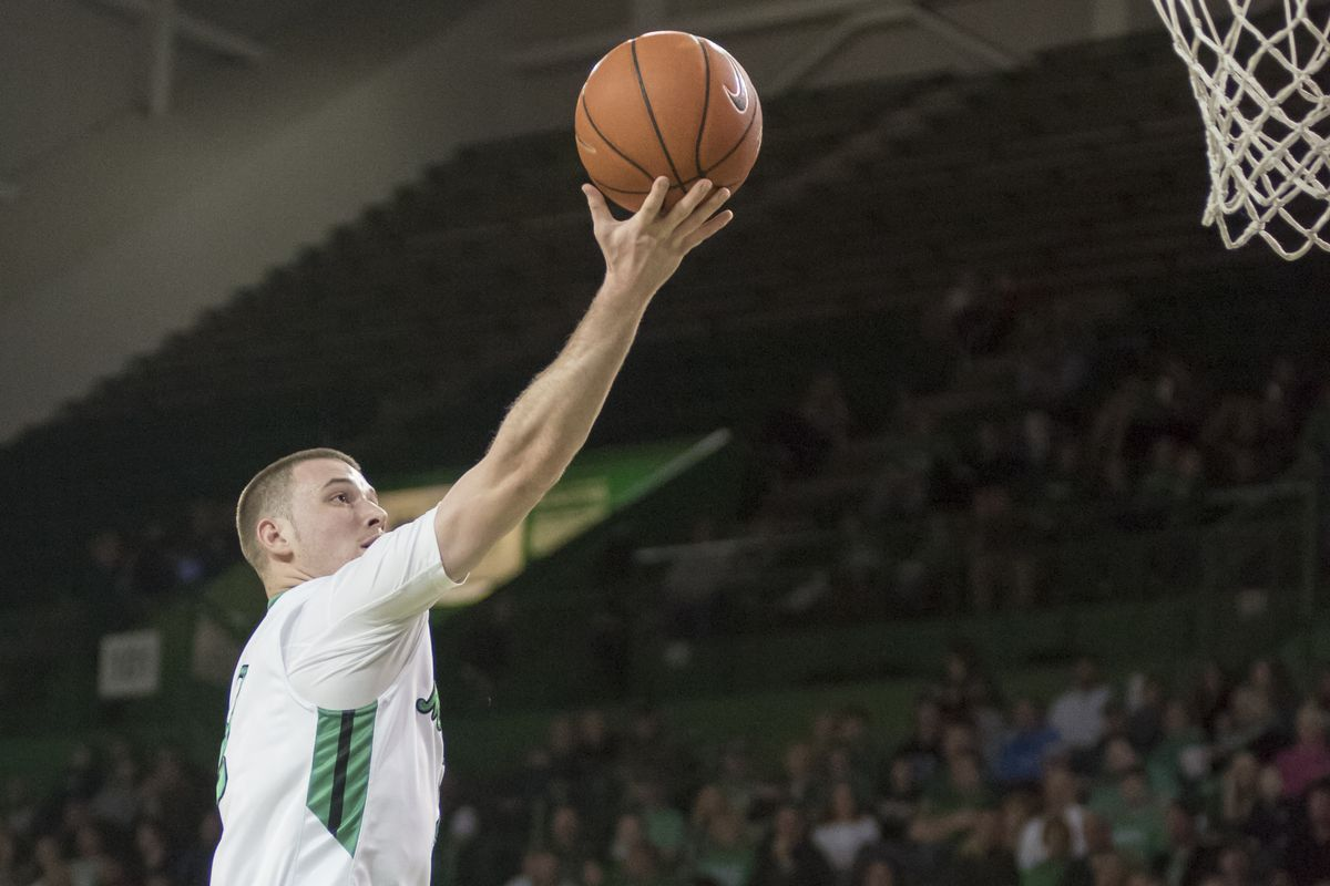 Stevie Browning (2) finishes at the rim for the Herd.