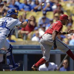 Arizona Diamondbacks' Chris Young, right, is caught between third base and home plate as Los Angeles Dodgers catcher Matt Treanor throws to third during the first inning of their baseball game, Sunday, Sept. 2, 2012, in Los Angeles. Young was tagged out on the play.
