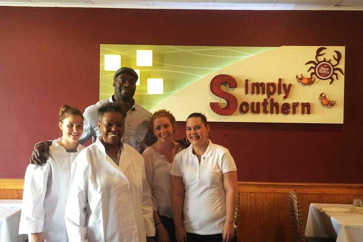 Rasheed Simmons and the restaurant staff.