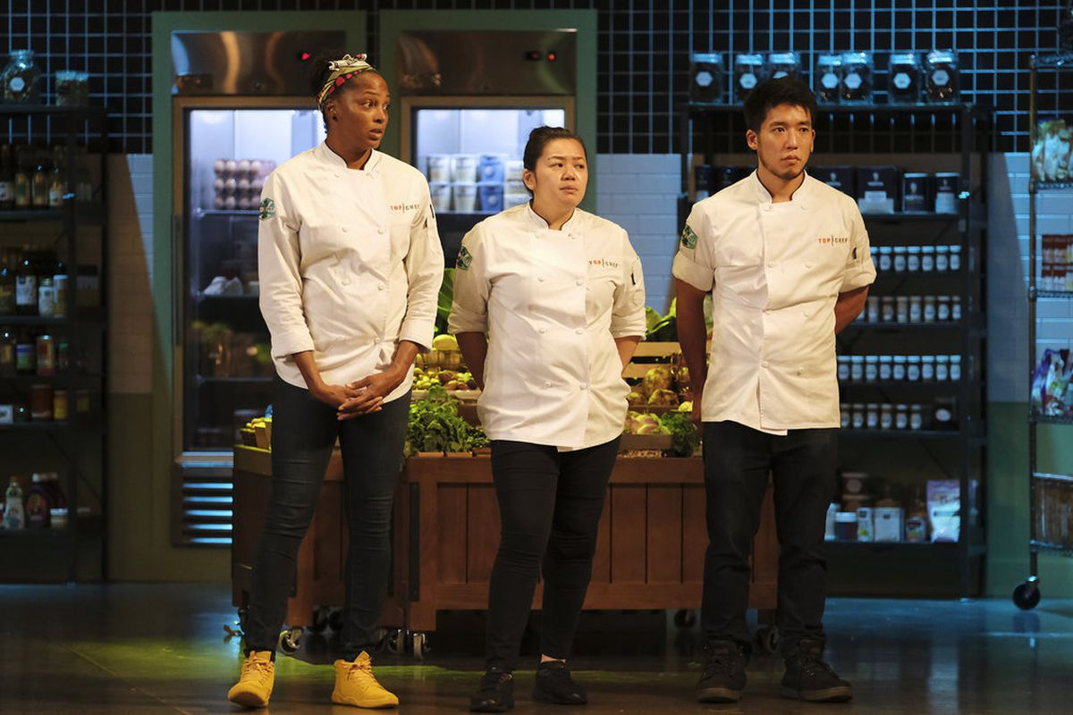 Three chefs stand in a row