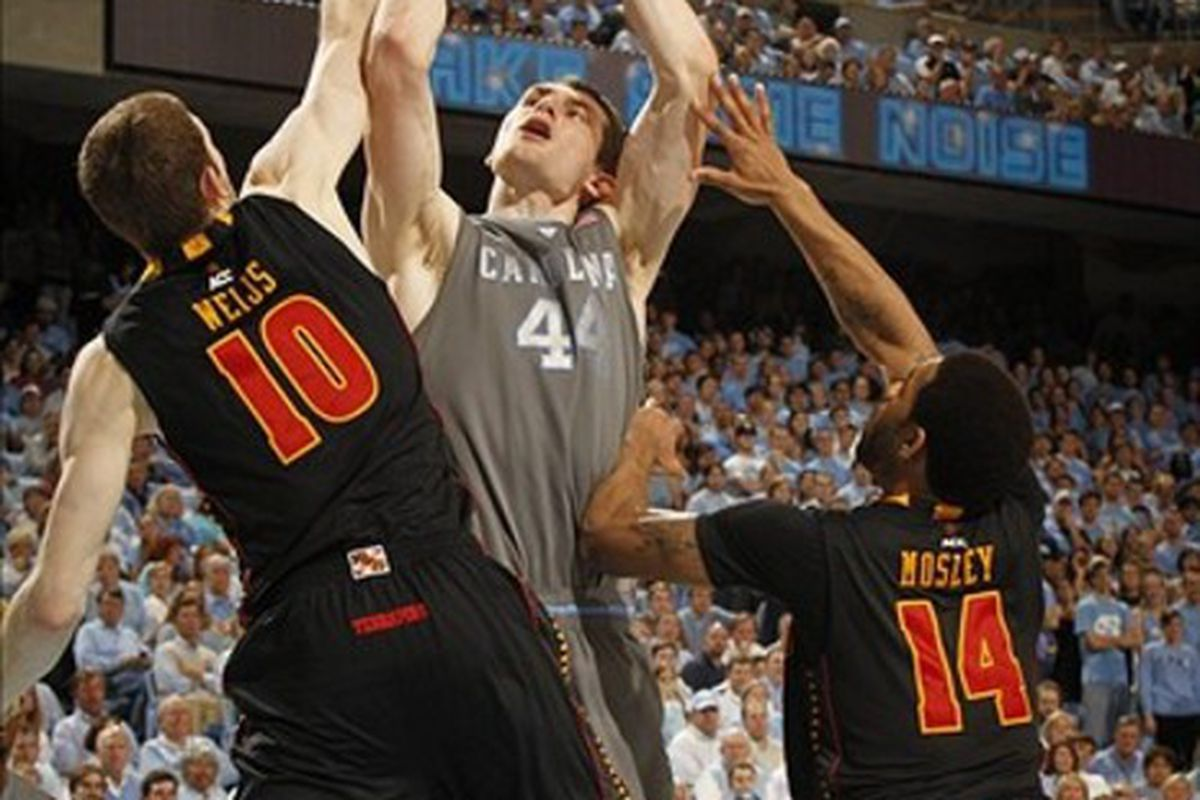 Tyler Zeller shoots as Maryland Terrapins center Berend Weijs (10) and guard Sean Mosley (14) defend in the second half. The Tar Heels defeated the Terrapins 88-64.